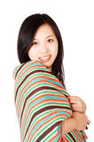 Woman in shawl. Young asian woman wearing a colorful shawl Royalty Free Stock Images