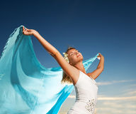Woman with a shawl. Beautiful young woman with a shawl relaxing outdoors stock photo