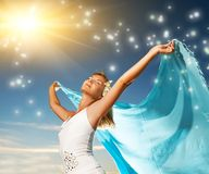Woman with a shawl. Beautiful young woman with a shawl relaxing outdoors Stock Photography