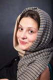 Woman shawl close up face portrait. Hand face touch. Stock Photos