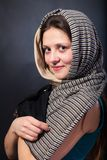 Woman shawl close up face portrait. Hand face touch. Stock Image