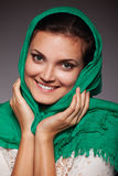 Woman shawl close up face portrait. Hand face touch Royalty Free Stock Image