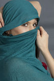 Woman with shawl on face. Woman with green  shawl on face Royalty Free Stock Photo