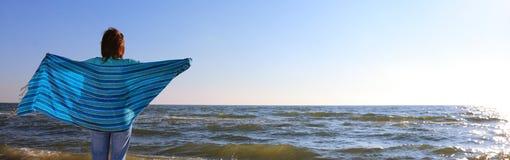 Woman and shawl at sea shore. Blue woman and shawl at sea shore Stock Photos