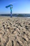 Woman and shawl at sea shore Stock Photography