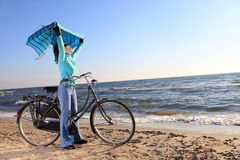 Woman and shawl at sea shore Royalty Free Stock Image