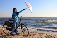 Woman and shawl at sea shore Royalty Free Stock Photo