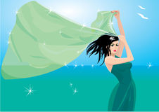 Woman with shawl on seaside Royalty Free Stock Images