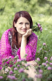 Woman in a  shawl  sitting in grass Stock Photos