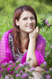 Woman in a  shawl  sitting in grass Royalty Free Stock Photos