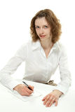 Woman with sheet of paper and a pen Stock Image