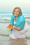 Woman with  shell Royalty Free Stock Image