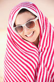 Woman Sheltering From Sun On Beach Holiday. Under Beach Towel Stock Image