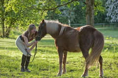 Woman and Shetland pony Royalty Free Stock Photography