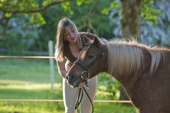 Woman and Shetland pony Royalty Free Stock Photos
