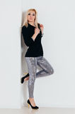 Woman in shine pants and black jacket Royalty Free Stock Photos