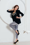Woman in shine pants and black jacket Stock Photos