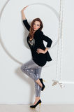 Woman in shine pants and black jacket Royalty Free Stock Images