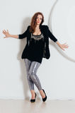 Woman in shine pants and black jacket Stock Photography