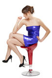 Woman in shiny blue dress. Beautiful woman in shiny blue dress sitting on the stool Stock Images