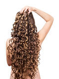 Woman with shiny brown curls isolated on white background. Stock Photo