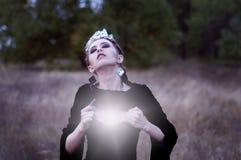 Woman with shiny heart Stock Photo