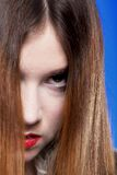Woman shiny straight long hair and make-up Stock Photos