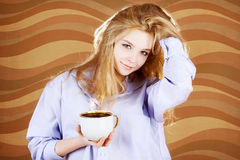 Woman in shirt with cup Royalty Free Stock Photography