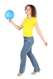 Woman in shirt and jeans with blue balloon Royalty Free Stock Images