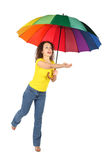 Woman in shirt with multicolored umbrella Stock Photos