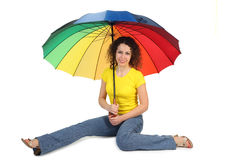 Woman in shirt with multicolored umbrella Royalty Free Stock Photography