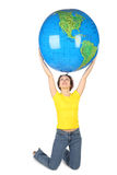 Woman in shirt sitting and holding big globe. Young woman in yellow shirt sitting and holding big globe, isolated on white Royalty Free Stock Images