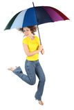 Woman in shirt with umbrella jumping stock image