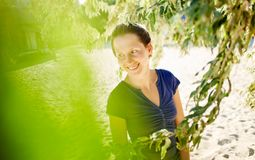 Woman in shirt under olive tree Royalty Free Stock Images