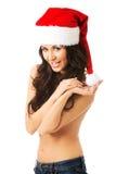 Woman shirtless wearing santa claus hat Royalty Free Stock Image