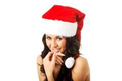 Woman shirtless wearing santa claus hat Royalty Free Stock Photos