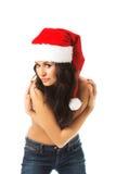 Woman shirtless wearing santa hat bends to camera Royalty Free Stock Image