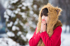 Woman shivering from cold outdoors in wintertime Royalty Free Stock Photography