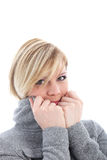 Woman shivering in the winter cold Stock Images