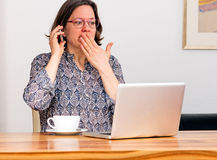 Woman is shocked by email Stock Photography