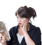 Woman shocked by her appearance Royalty Free Stock Images
