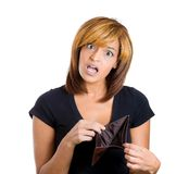 Woman shocked at her empty wallet Royalty Free Stock Photos