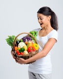 Woman shocked at her healthy basket of vegetables Stock Photo