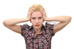 Woman shocked holding her head. Surprised and shocked blonde short hair woman with pixie cut holding her head in hands. Isolated on white Stock Photography
