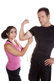Woman shocked when measuring mans arm Stock Photo