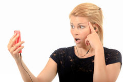 Woman shocked by text message Royalty Free Stock Image