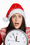 Woman shocked at the time. On white background Stock Image