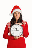 Woman shocked at the time. On white background Stock Photos