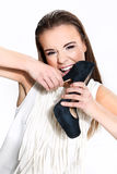 Woman with shoe. Woman with black shoe Royalty Free Stock Photography