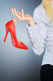 Woman with shoe Royalty Free Stock Images